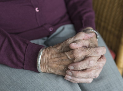 Clasped-Hands-of-a-Senior-Woman-who-is-sitting-in-nursing-home-in-poland